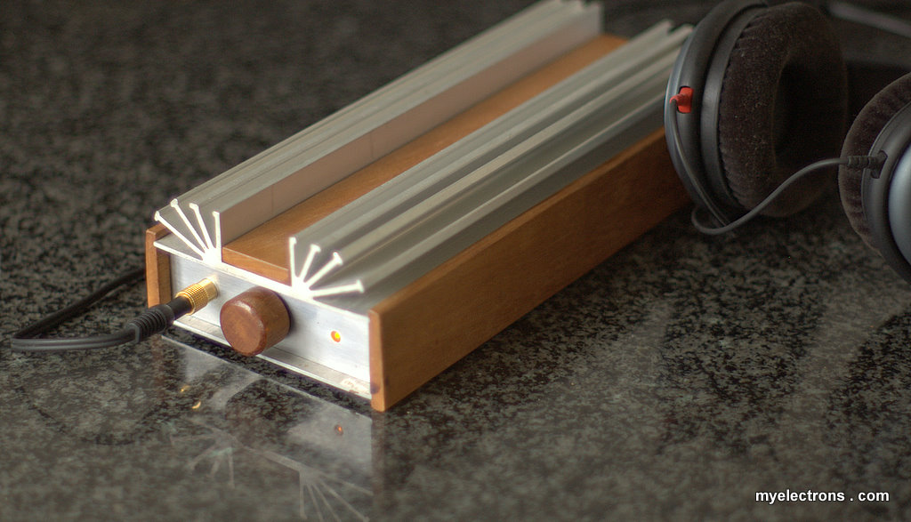 Amplifier in the red-wood and aluminum case